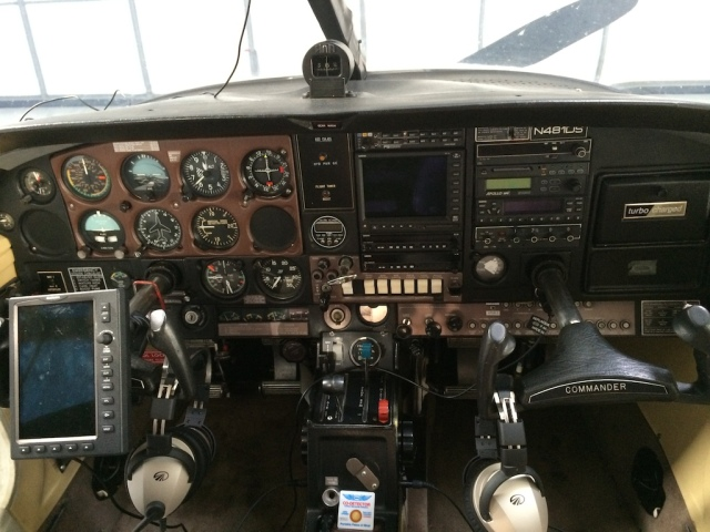 Cockpit w Garmin 696 & Headsets
